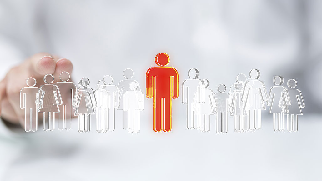 Illustrasjonsfigurer av mennesker hvor alle er hvite og en er rød